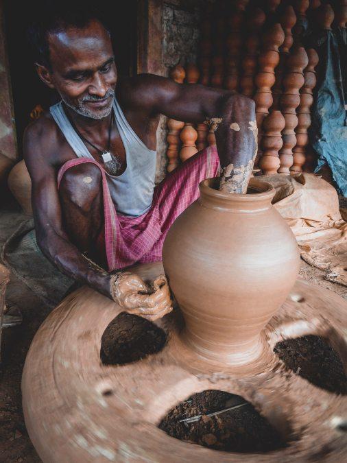 man-making-clay-pot-1102292